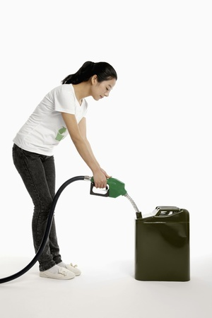 Woman pumping Gas into a Fuel container